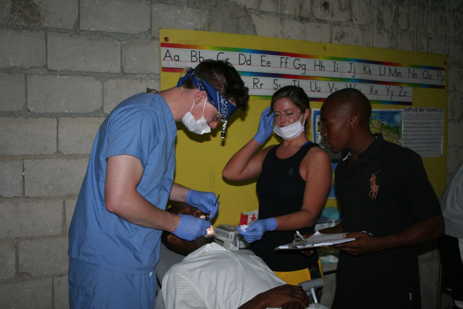 Dr Nate and Lynsey extracting teeth